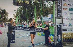 Melissa Perlman Crossing the finish line at marathon race