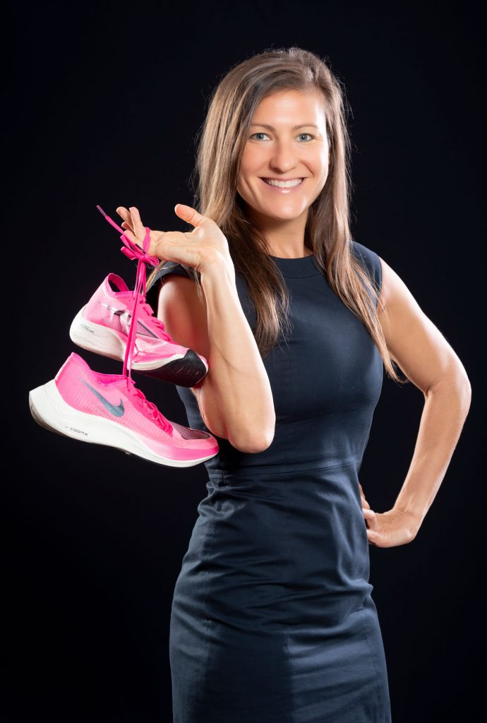 Melissa Perlman holding her running shoes